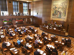 FILE - In this June 29, 2019, file photo, lawmakers convene at the Oregon Senate after the minority Republicans ended a walkout they had begun on June 20 over a carbon-emissions bill they said would harm their rural constituents, at the Oregon Senate in Salem, Ore. When Democrats won a supermajority in the Oregon Legislature in the 2018 election, the party was excited. But now Democrats know the limits of that power after Republican senators staged a dramatic nine-day boycott that ended up killing major climate change legislation. (AP Photo/Andrew Selsky, File)