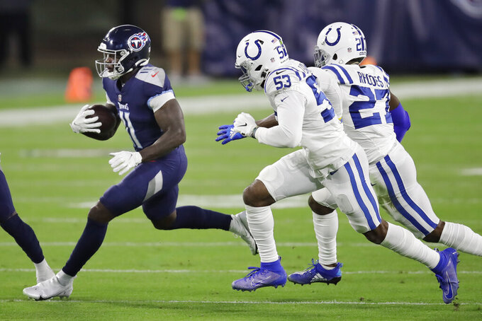 Tennessee Titans wide receiver A.J. Brown (11) carries the ball ahead of Indianapolis Colts defenders Darius Leonard (53) and Xavier Rhodes (27) in the first half of an NFL football game Thursday, Nov. 12, 2020, in Nashville, Tenn. (AP Photo/Ben Margot)