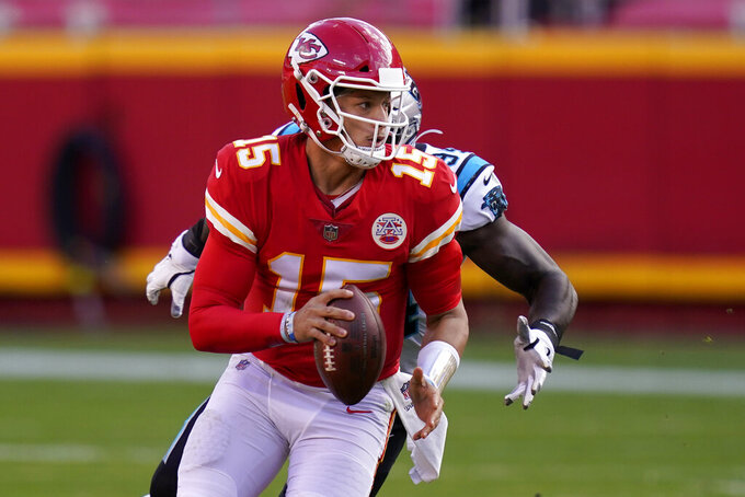 Kansas City Chiefs quarterback Patrick Mahomes (15) scrambles against the Carolina Panthers during the second half of an NFL football game in Kansas City, Mo., Sunday, Nov. 8, 2020. (AP Photo/Orlin Wagner)