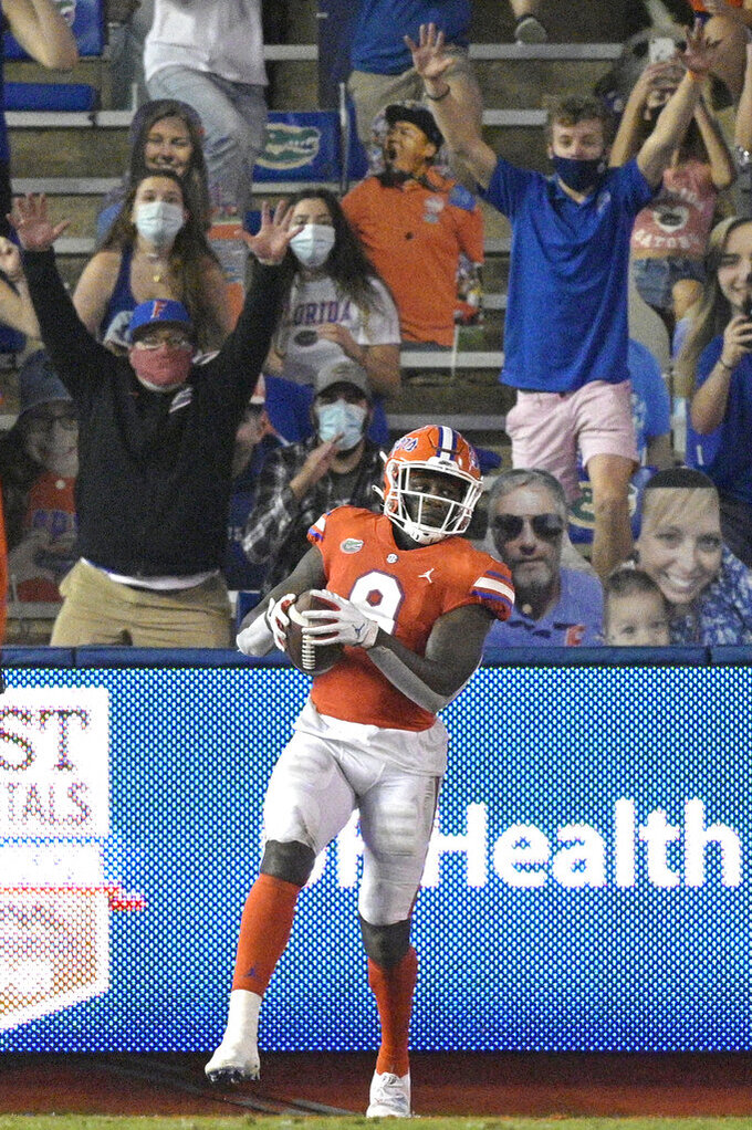 Florida tight end Keon Zipperer (9) catches a pass in the end zone for an 11-yard touchdown during the second half of an NCAA college football game against Arkansas, Saturday, Nov. 14, 2020, in Gainesville, Fla. (AP Photo/Phelan M. Ebenhack)