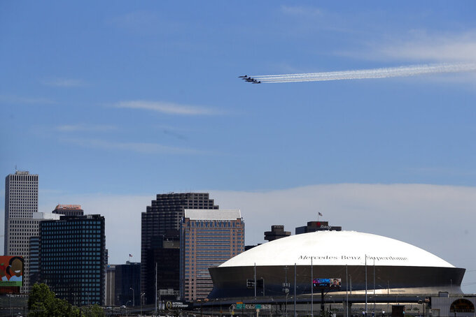 The Blue Angels, the U.S. Navy flight demonstration squadron, flies over downtown New Orleans and the Mercedes-Benz Superdome, as a salute to the health care front line responders working to help the sick during the coronavirus pandemic, Wednesday, May 6, 2020. (AP Photo/Gerald Herbert)