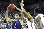 Auburn center Austin Wiley (50) defends against a shot by Lipscomb guard Andrew Fleming (2) during the first half of an NCAA college basketball game Sunday, Dec. 29, 2019, in Auburn, Ala. (AP Photo/Julie Bennett)