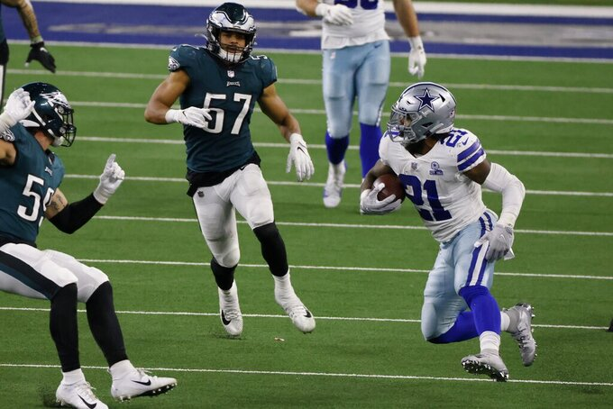 Philadelphia Eagles linebacker Joe Bachie, left, and linebacker Luke Gifford (57) move in to stop Dallas Cowboys running back Ezekiel Elliott (21) after a long gain in the second half of an NFL football game in Arlington, Texas, Sunday, Dec. 27. 2020. (AP Photo/Ron Jenkins)