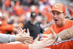 Clemson head coach Dabo Swinney high-fives fans after an NCAA college football game against South Carolina, Saturday, Nov. 30, 2019, in Columbia, S.C. Clemson won 38-3. (AP Photo/Sean Rayford)