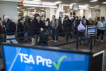 Passengers wait in line at a Transportation Security Administration checkpoint at the Philadelphia International Airport in Philadelphia, Friday, Jan. 11, 2019. (AP Photo/Matt Rourke)
