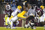 Texas A&M defensive lineman DeMarvin Leal (8) upends LSU quarterback TJ Finley (11) for a sack during the second quarter of an NCAA college football game Saturday, Nov. 28, 2020, in College Station, Texas. (AP Photo/Sam Craft)