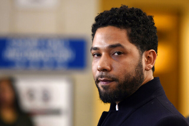 "FILE - In this March 26, 2019, file photo, actor Jussie Smollett talks to the media before leaving Cook County Court after his charges were dropped in Chicago. A special prosecutor decided to prosecute Smollett again, 11 months after county prosecutors dropped charges that the ""Empire"" actor hired two men to fake the attack to further his career. (AP Photo/Paul Beaty, File)"