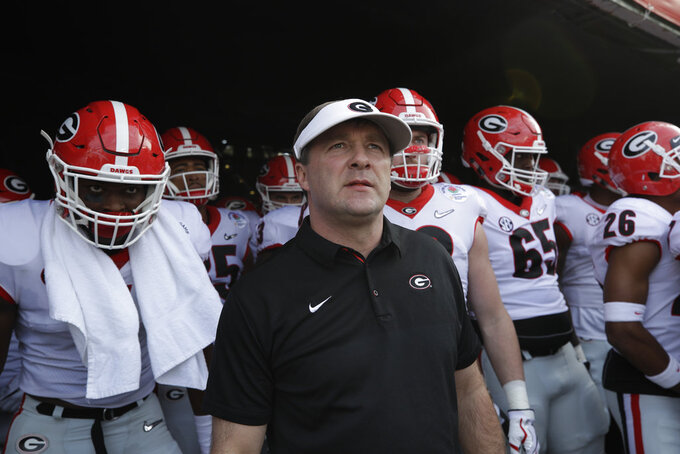 FILE - In this Jan. 1, 2018, file photo, Georgia head coach Kirby Smart waits with his team to run onto the field before the Rose Bowl NCAA college football game against Oklahoma in Pasadena, Calif. After falling to Alabama in last season's national championship game, No. 3 Georgia opens a fresh start with hopes for another title run when the Bulldogs face Austin Peay on Saturday.(AP Photo/Jae C. Hong, File)