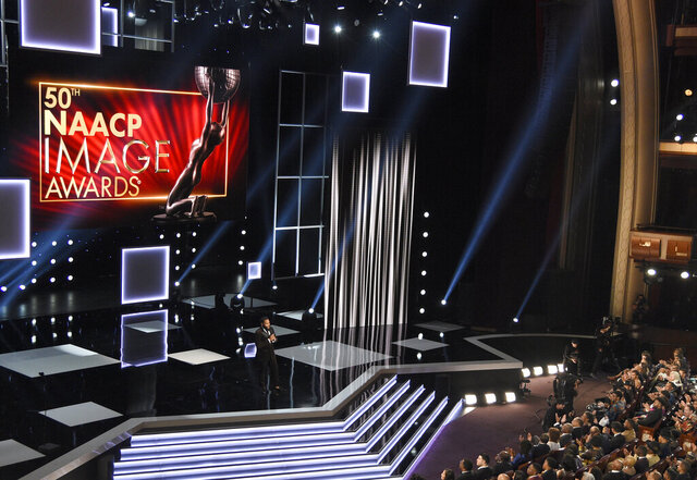 FILE - In this March 30, 2019, file photo, host Anthony Anderson speaks at the 50th annual NAACP Image Awards on Saturday, March 30, 2019, at Dolby Theatre in Los Angeles. Anderson is scheduled to host this year's edition of the NAACP Image Awards on Saturday night, Feb. 22.  (Photo by Chris Pizzello/Invision/AP, File)