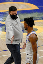 Pittsburgh head coach Jeff Capel, left, greets Au'diese Toney (5) during a timeout in the first half of an NCAA college basketball game against Syracuse, Saturday, Jan. 16, 2021, in Pittsburgh. Pittsburgh won 96-76. (AP Photo/Keith Srakocic)
