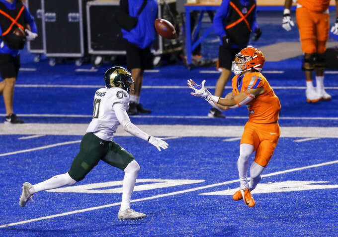 Boise State wide receiver Khalil Shakir, right, turns back for the ball on a 39-yard reception next to Colorado State defensive back Tywan Francis (10) during the second half in an NCAA college football game Thursday, Nov. 12, 2020, in Boise, Idaho. Boise State won 52-21. (AP Photo/Steve Conner)