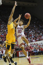 Indiana guard Rob Phinisee (10) goes to the basket around Wichita State forward Jaime Echenique (21) in the second half of an NCAA college basketball game in the third round of the NIT tournament, in Bloomington, Ind., Tuesday, March 26, 2019. Wichita State won 73-63. (AP Photo/AJ Mast)