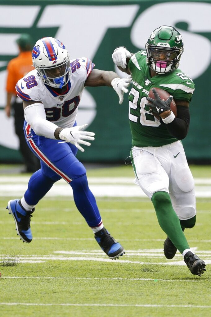 New York Jets' Le'Veon Bell (26) runs past Buffalo Bills' Shaq Lawson (90) during the second half of an NFL football game Sunday, Sept. 8, 2019, in East Rutherford, N.J. (AP Photo/Seth Wenig)