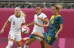 Australia's Emily Van Egmond, right, and United States' Alex Morgan battle for the ball during a women's soccer match at the 2020 Summer Olympics, Tuesday, July 27, 2021, in Kashima, Japan. (AP Photo/Fernando Vergara)