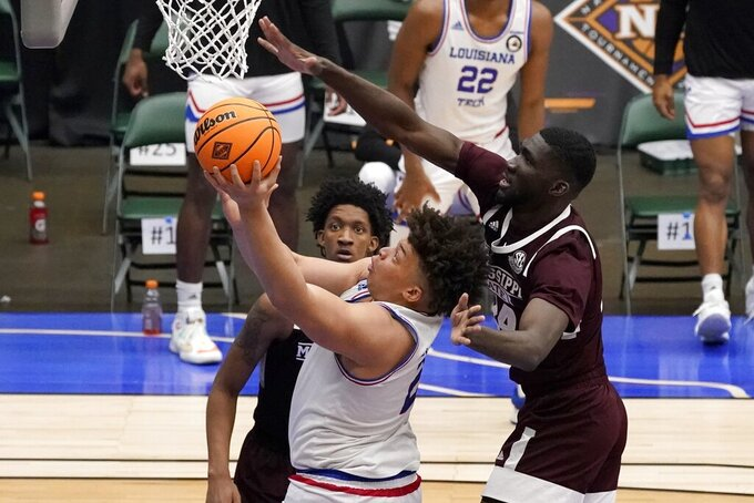 Louisiana Tech forward Kenneth Lofton Jr., left, goes up for a shot as Mississippi State forward Abdul Ado, right, defends in the second half of an NCAA college basketball game in the semifinals of the NIT, Saturday, March 27, 2021, in Frisco, Texas. (AP Photo/Tony Gutierrez)