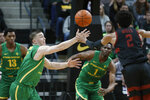 Oregon guard Payton Pritchard (3) steals the ball from Stanford guard Bryce Wills (2) during the first half of an NCAA college basketball game in Eugene, Ore., Saturday, March 7, 2020. (AP Photo/Thomas Boyd)