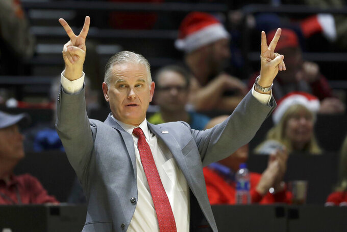 FILE - In this Dec. 18, 2019, file photo, San Diego State head coach Brian Dutcher reacts during the second half of an NCAA college basketball game against San Diego Christian in San Diego. It's almost like coach Dutcher and the San Diego State Aztecs won the lottery. Tired of losing at their old schools, big man Yanni Wetzell and guards Malachi Flynn and KJ Feagin transferred to San Diego State after being lured by the prospect of winning and going to the NCAA Tournament. And boy, have they ever won, to the point that they've matched some accomplishments by the breakthrough 2010-11 team led by the most famous player in program history, Kawhi Leonard. (AP Photo/Gregory Bull, File)