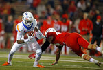 Boise State wide receiver CT Thomas, left, gets away from New Mexico linebacker Brandon Shook during the first half of an NCAA college football game in Albuquerque, N.M., Friday, Nov. 16, 2018. (AP Photo/Andres Leighton)