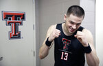 FILE - In this March 23, 2019, file photo, Texas Tech's Matt Mooney jokes with reporters outside the locker room after practice for their second round men's college basketball game in the NCAA Tournament, in Tulsa, Okla. Texas Tech has gotten to its first Final Four with contrasting guards Jarrett Culver and Matt Mooney. Mooney is a graduate transfer from South Dakota who filled a huge void at point guard after Tech's previous best season. (AP Photo/Charlie Riedel, File)