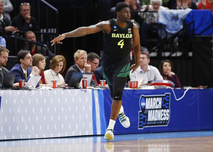 Baylor guard Mario Kegler gestures after scoring against Syracuse during the second half of a first-round game in the NCAA men's college basketball tournament Thursday, March 21, 2019, in Salt Lake City. (AP Photo/Jeff Swinger)