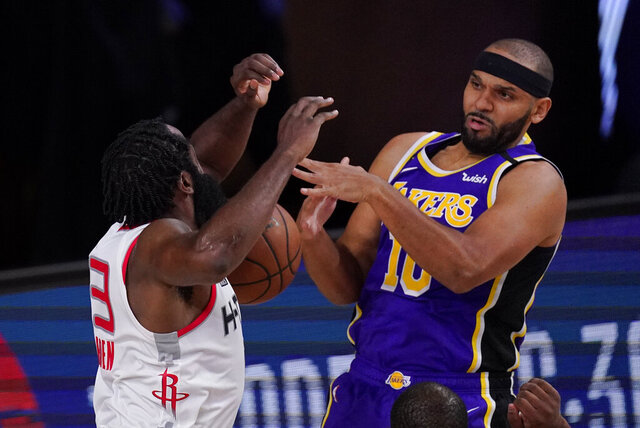 Houston Rockets' James Harden (13) fights for a rebound with Los Angeles Lakers' Jared Dudley (10) during the second half of an NBA conference semifinal playoff basketball game Friday, Sept. 4, 2020, in Lake Buena Vista, Fla. The Rockets won 112-97. (AP Photo/Mark J. Terrill)