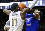 Vanderbilt forward Simisola Shittu (11) blocks the path of Tennessee State guard Donte Fitzpatrick-Dorsey (3) in the second half of an NCAA college basketball game Saturday, Dec. 29, 2018, in Nashville, Tenn. Vanderbilt won 95-76. (AP Photo/Mark Humphrey)
