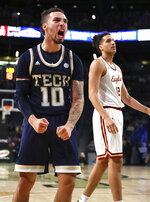 Georgia Tech guard Jose Alvarado reacts to scoring and drawing a foul from Boston College during an NCAA college basketball game on Sunday, March 3, 2019, in Atlanta. Boston College forward Johncarlos Reyes reacts to the play. (Curtis Compton/Atlanta Journal-Constitution via AP)