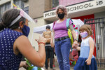 FILE- In this Sept. 2, 2020 file photo, teachers and students participate in an outdoor learning demonstration to display methods schools can use to continue on-site education during the coronavirus pandemic, at P.S. 15 in the Red Hook neighborhood of the Brooklyn borough of New York. New York City's already delayed school year is scheduled to start remotely on Wednesday, Sept. 16, 2020, in a soft opening that will serve as a prologue to the return of students to physical classrooms on the following week. (AP Photo/John Minchillo, File)