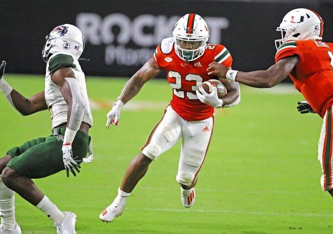 Miami running back Cam'Ron Harris (23) runs the ball in the third quarter against UAB during an NCAA college football game in Miami Gardens, Fla., Thursday, Sept. 10, 2020. (Al Diaz/Miami Herald via AP)