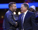 Los Angeles Rams head coach Sean McVay, left, shakes hands with New England Patriots head coach Bill Belichick during Opening Night for the NFL Super Bowl 53 football game Monday, Jan. 28, 2019, in Atlanta. (AP Photo/David J. Phillip)