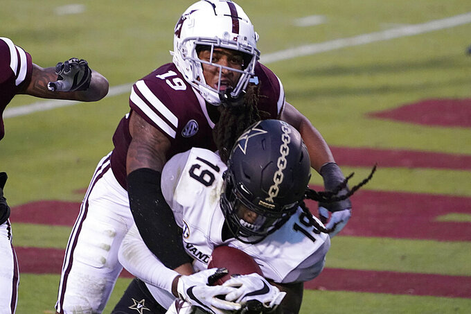 Vanderbilt wide receiver Chris Pierce Jr. (19) holds on to a 2-yard touchdown pass reception as Mississippi State safety Collin Duncan (19) tries to strip him of the ball during the second half of an NCAA college football game in Starkville, Miss., Saturday, Nov. 7, 2020. (AP Photo/Rogelio V. Solis)
