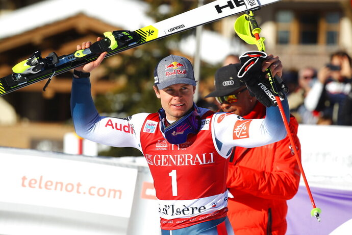 First classified France's Alexis Pinturault celebrates at the finish area of an alpine ski, men's World Cup slalom in Val d' Isere, France, Sunday, Dec. 15, 2019. (AP Photo/Marco Trovati)