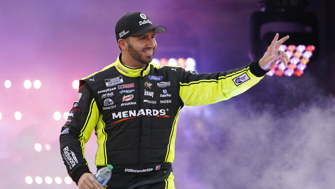 Matt DiBenendetto waves to the crowd during driver introductions prior to the start of the NASCAR Cup series auto race in Richmond, Va., Saturday, Sept. 11, 2021. (AP Photo/Steve Helber)