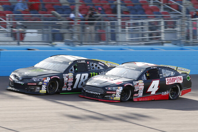 David Gilliland (4) and Ty Gibbs (18) compete for the lead through Turn 4 during the ARCA Series auto race at Phoenix Raceway, Saturday, Nov. 7, 2020, in Avondale, Ariz. (AP Photo/Ralph Freso)