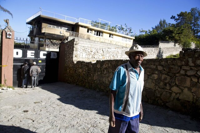 Simon Comie walks away from the Orphanage of the Church of Bible Understanding, after asking about the whereabouts of his 4-year-old daughter in Kenscoff, just outside of Port-au-Prince, Haiti, Saturday, Feb. 15, 2020. A fire swept through the children's home run by a Pennsylvania-based religious nonprofit group, killing 15 children, officials said Friday. It is common in Haiti for impoverished parents to place children in residential care centers, where they receive lodging and widely varying education for several years but are not technically orphans. (AP Photo/Dieu Nalio Chery)
