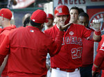 Los Angeles Angels' Mike Trout (27) celebrates with teammates in the dugout after a two-run home run against the Seattle Mariners during the third inning of a baseball game Saturday, July 13, 2019, in Anaheim, Calif. (AP Photo/Marcio Jose Sanchez)