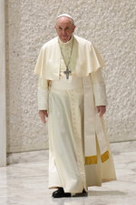 Pope Francis arrives for his weekly general audience in the Paul VI hall, at the Vatican, Wednesday, Sept. 8, 2021. (AP Photo/Andrew Medichini)