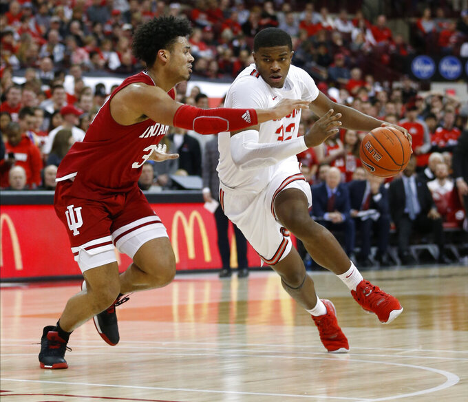 Ohio State's E.J. Liddell, right, drives to the basket against Indiana's Justin Smith during the second half of an NCAA college basketball game Saturday, Feb. 1, 2020, in Columbus, Ohio. Ohio State beat Indiana 68-59. (AP Photo/Jay LaPrete)