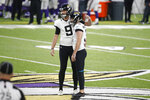Jacksonville Jaguars place kicker Chase McLaughlin, right, reacts with teammate Logan Cooke (9) after missing a field goal in the second half of an NFL football game against the Minnesota Vikings, Sunday, Dec. 6, 2020, in Minneapolis. The Vikings won 27-24 in overtime. (AP Photo/Bruce Kluckhohn)