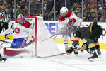 Montreal Canadiens goaltender Carey Price blocks a shot by Vegas Golden Knights left wing William Carrier, right, during the second period in Game 2 of an NHL hockey Stanley Cup semifinal playoff series, Wednesday, June 16, 2021, in Las Vegas. (AP Photo/John Locher)