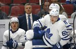 New Toronto Maple Leafs head coach Sheldon Keefe, center top, watches the action along with Maple Leafs right wing Kasperi Kapanen (24) as Maple Leafs right wing Ilya Mikheyev (65) heads to the ice during the first period of an NHL hockey game against the Arizona Coyotes, Thursday, Nov. 21, 2019, in Glendale, Ariz. (AP Photo/Ross D. Franklin)