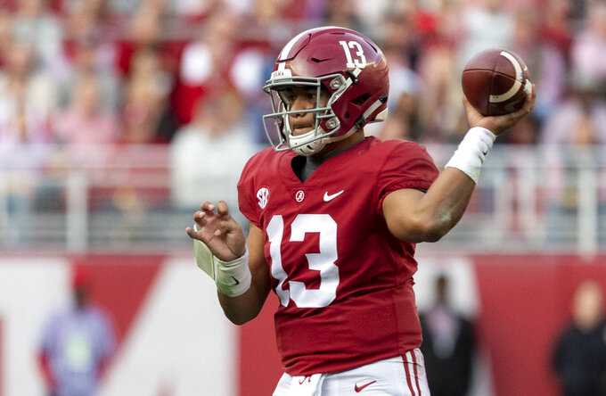 Alabama quarterback Tua Tagovailoa (13) drops back to pass against Auburn during the first half of an NCAA college football game, Saturday, Nov. 24, 2018, in Tuscaloosa, Ala. (AP Photo/Vasha Hunt)
