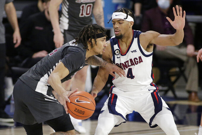 Santa Clara guard Giordan Williams, left, drives while pressured by Gonzaga guard Aaron Cook during the second half of an NCAA college basketball game in Spokane, Wash., Thursday, Feb. 25, 2021. (AP Photo/Young Kwak)