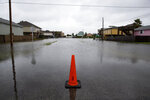 A flooded street in Rockport, Texas, as Tropical Storm Beta approaches on Monday, Sept. 21, 2020.  (Courtney Sacco/Corpus Christi Caller-Times via AP)