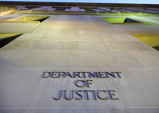 FILE - In this May 14, 2013, file photo, the Department of Justice headquarters building in Washington is photographed early in the morning. The Executive Office for Immigration Review is the arm of the Justice Department that oversees deportation proceedings _ whether immigrants are allowed stay in the U.S. or whether they are turned back to their countries. (AP Photo/J. David Ake, File)