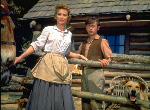 "This image released by Disney shows Dorothy McGuire, left, and Tommy Kirk in a scene from the 1957 classic ""Old Yeller."
