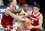 Arizona guard James Akinjo (13) almost breaks up the hand off between Stanford forward James Keefe, left, and guard Michael O'Connell (5) during the second half of an NCAA college basketball game in Tucson, Ariz., Thursday, Jan. 28, 2021. (Kelly Presnell/Arizona Daily Star via AP)
