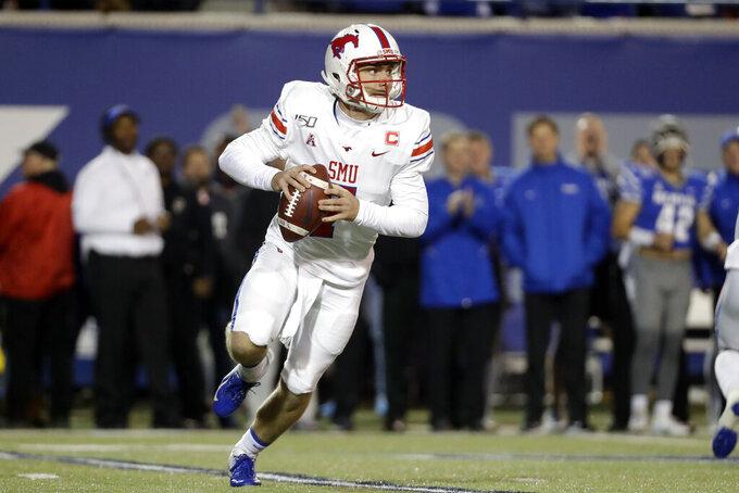 SMU quarterback Shane Buechele scrambles against Memphis in the first half of an NCAA college football game Saturday, Nov. 2, 2019, in Memphis, Tenn. (AP Photo/Mark Humphrey)