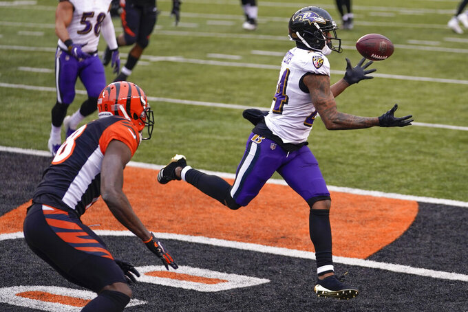 Baltimore Ravens cornerback Marcus Peters (24) intercepts a pass in the end zone intended for Cincinnati Bengals wide receiver A.J. Green (18) during the second half of an NFL football game, Sunday, Jan. 3, 2021, in Cincinnati. (AP Photo/Bryan Woolston)