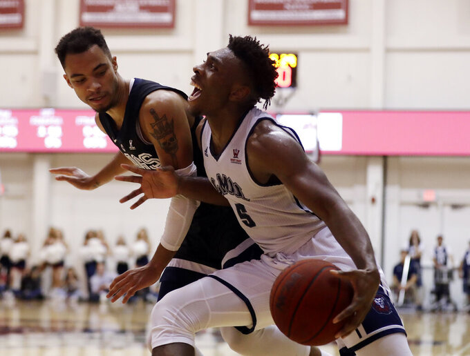 Loyola Marymount guard James Batemon, right, is defended by Gonzaga guard Geno Crandall during the second half of an NCAA basketball game Thursday, Feb. 14, 2019, in Los Angeles. (AP Photo/Marcio Jose Sanchez)